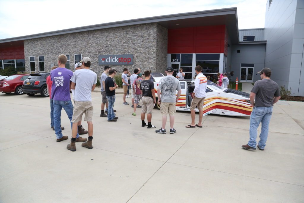 Clickstoppers and community members gather to check out the solar car.